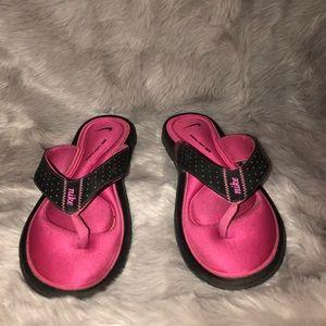 Pink Nike cushion flip flops